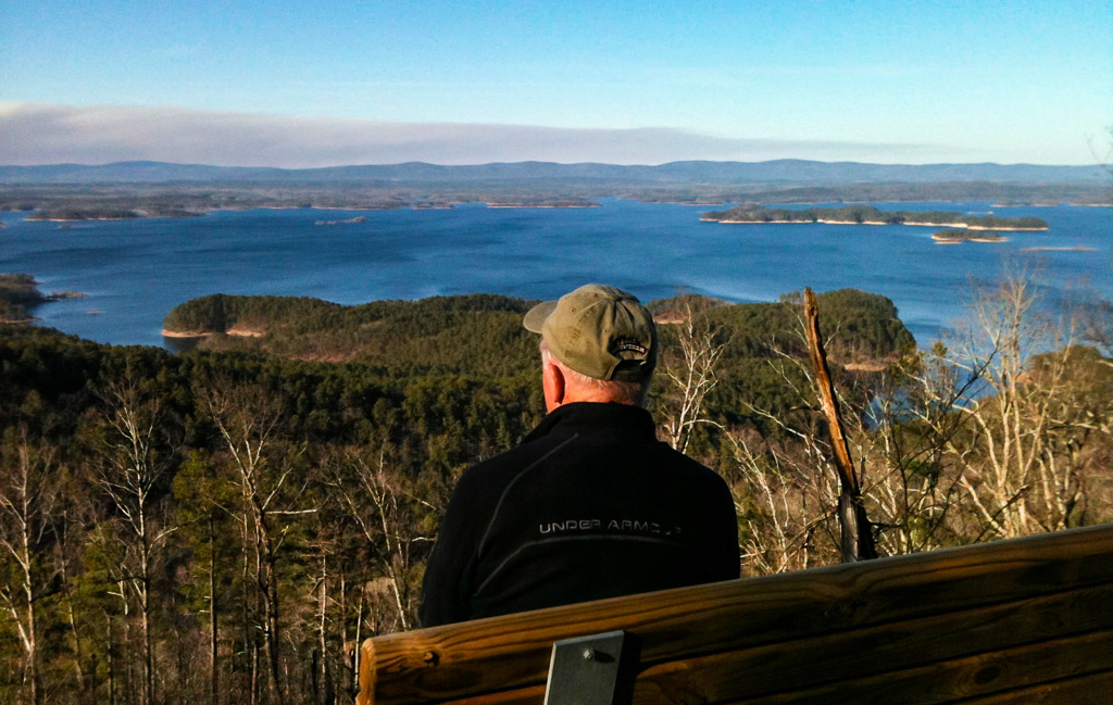 "Alpha Dog Jerry Shields enjoys the view from the ""Traildog Vista"" bench on Bear Mountain"
