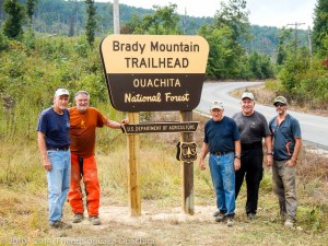 Traildogs showing off the new sign along Brady Mountain Road.