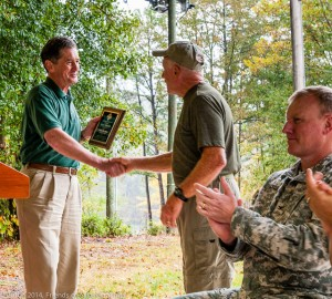 "Joe David Rice presents the Arkansas State Trails Council's award for Trails Advocate of the Year to ""Alpha"" Traildog Jerry Shields."