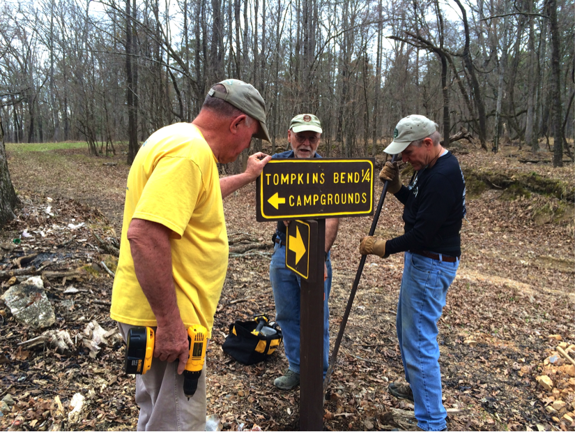 Traildogs installing new signage.