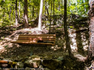 The second bench, located below a neat rock outcropping near the intersection of Rick's Road and Spillway Road.