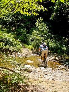 Clinton crossing a creek along the LOViT.