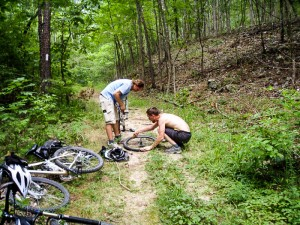 Repairing a flat tire on the way back to camp.