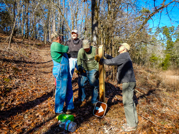 "Mike makes sure the new sign is level as Robert prepares to secure it to the post. Al and Ron provide moral support. (34°32'28"" N 93°22'42"" W)<br />(Click on this image to view more photos from Jan. 4, 2016)"